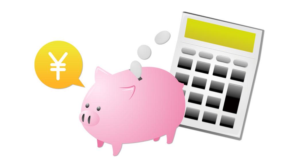 豚の貯金箱と電卓の画像